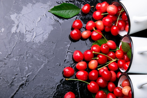 Scattered cherry from enamel cups,
