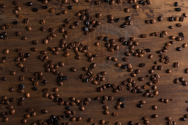 Scattered coffee beans on table