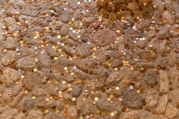Scattered coins lay on the stone floor,coins on the floor