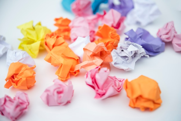 Scattered crumple paper on white background