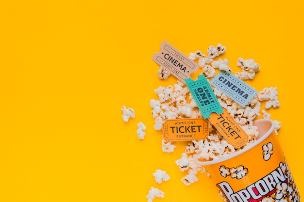 Scattered popcorn box with cinema tickets
