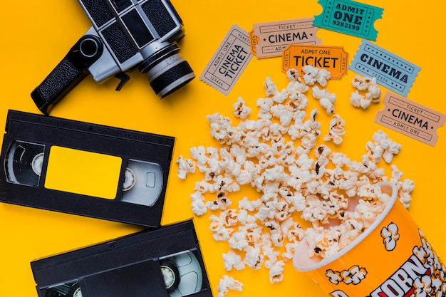 Scattered popcorn box with videotape