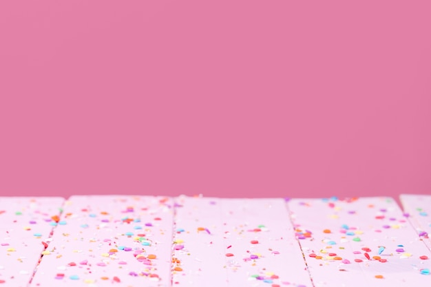 Scattered sweet sprinkles copy space