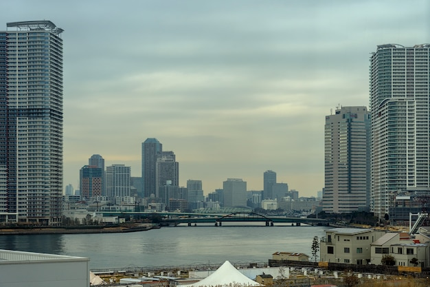 Scene of building cityscape with bridge in twilight time around odaiba area, tokyo, japan