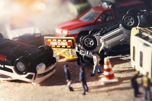 Scene of cars (miniature, toy model ) accident on street.insurance / terrorism concept.