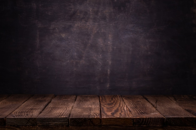 Scene creator.   empty wooden deck table with dark concrete wall background.