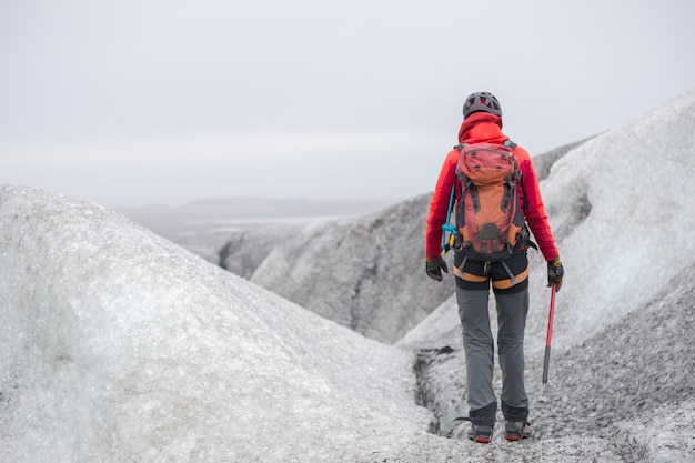 Scene of the girl climbing the glacier.
