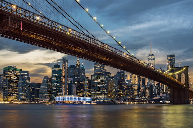 Scene of new york city skyline and brooklyn bridge over the easgt river, manhattan, usa