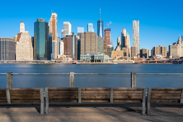 Scene of new york cityscape river side with east river at the morning time under blue sky