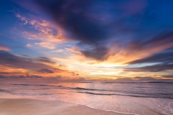 Scene of beautiful pastel sweet sunset sunrise twilight sky over sea beach