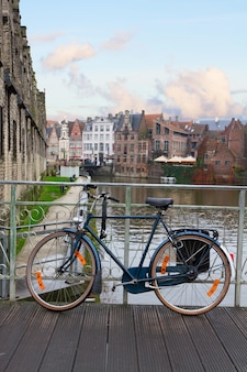 Scene in old town with bicycle on bridge, ghent, belgium