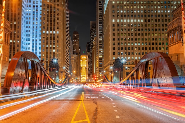 Scene of traffic lights of cars via one of bridge of chicago downtown, usa downtown