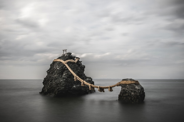 Scenery of holy rocks connected with a rope in mie-prefecture