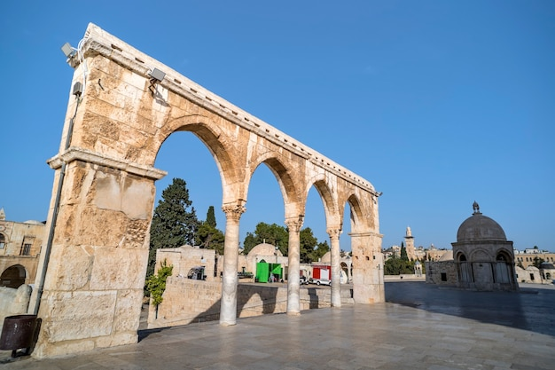 Scenery of old town of jerusalem with arches and a mosque. main entrance to dome of the rock is a muslim mosque.