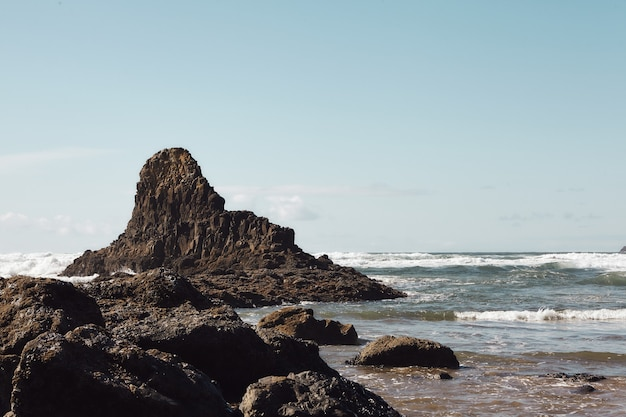 Scenery of rocks at the coastline of the pacific northwest in cannon beach, oregon