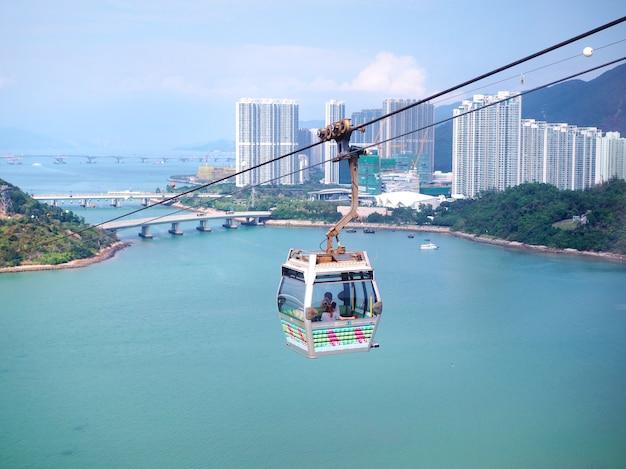 Scenery of sea, sky and city from ngong ping 360 cable car in lantau island, hong kong.