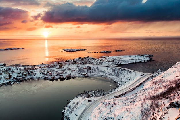 Scenery snow covered on reine in lofoten islands at sunset