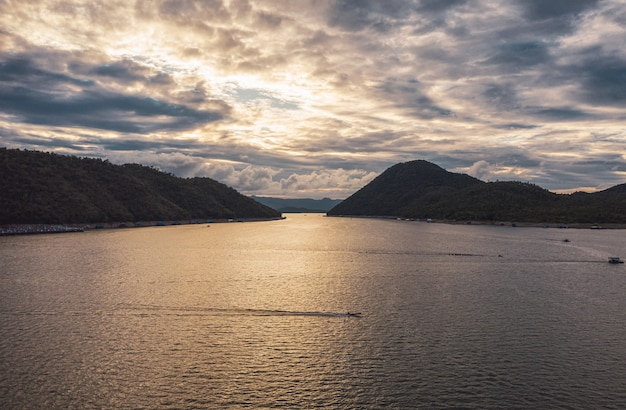 Scenery of srinagarind dam in valley at sunset