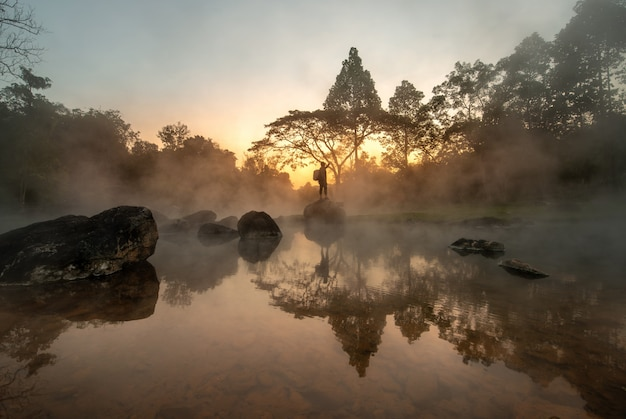 Scenery of sunrise behind hot spring at chae son national park, lampang, thailand