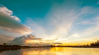 Scenery sunset over calm lake landscape panorama
