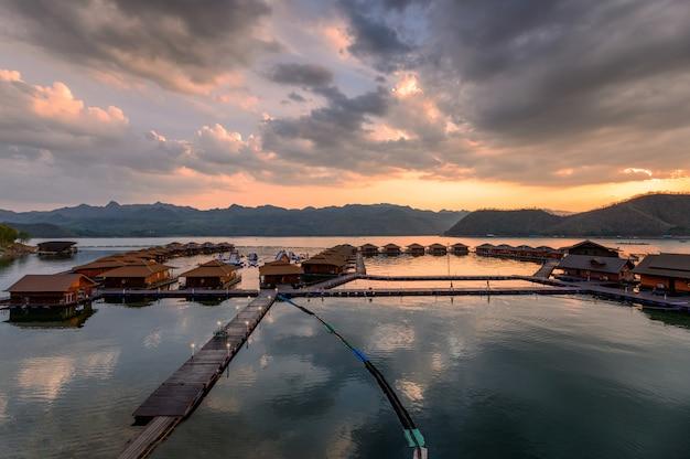 Scenery of wooden raft resort floating on srinakarin dam in evening