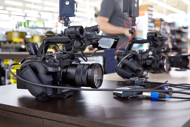 Behind the scenes of movie shooting or video production and film crew team with camera equipment