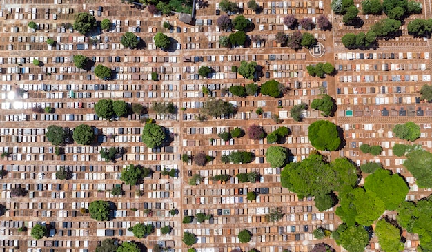 Scenic aerial flight directly above densely packed cemetery graveyard