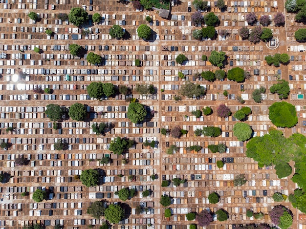 Scenic aerial flight directly above densely packed cemetery graveyard.