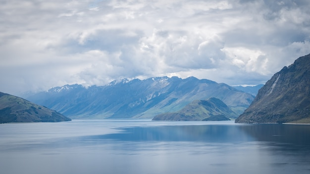 Scenic alpine lake surrounded by mountains shot on sunny day location is lake hawea new zealand