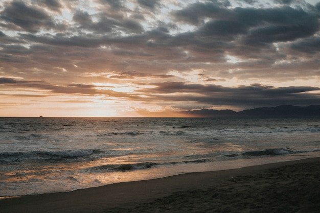 Scenic gloomy sunset on the beach