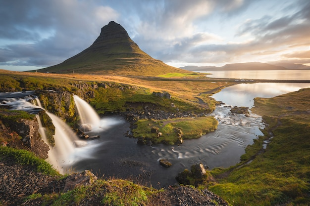 Scenic image of iceland. great view on famouse mount kirkjufell during sunrise. popular travel destinations.
