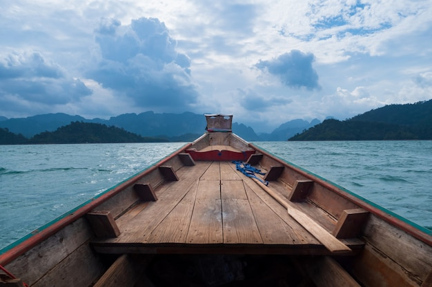 Scenic landscape of boat view in the big river and reservoir dam with mountain and nature forest