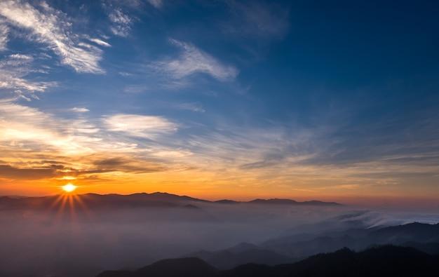 Scenic natural sunlight, sunrise orange, white mist flowed beautifully.