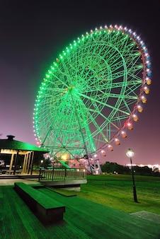 Scenic night illumination of big ferris wheel