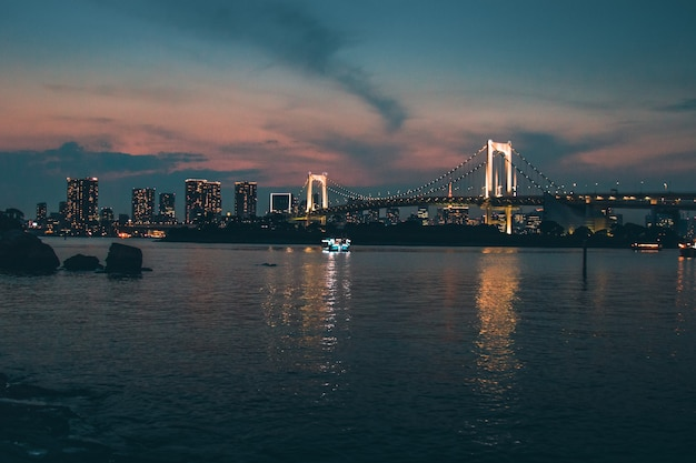 Scenic photo of city during dawn with views to the rainbow bridge, minato city, japan