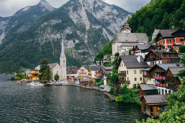 Scenic picture-postcard view of famous historic hallstatt mountain village in the austrian