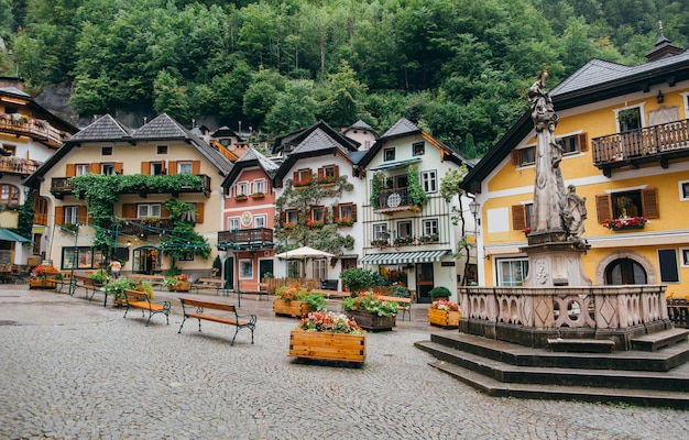 Scenic picture-postcard view of the historic town square of hallstatt with colorful houses