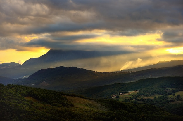 Scenic sunset landscape of the mountains in caselle in pittari, region campania, italy