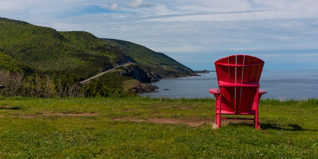 Scenic view of an adirondack chair at coast, petit etang, cape breton highlands national park, cape