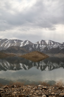 Scenic view of the azat reservoir in armenia with the reflection of the mountain range