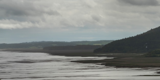 Scenic view of beach at hopewell rocks, bay of fundy, new brunswick, canada