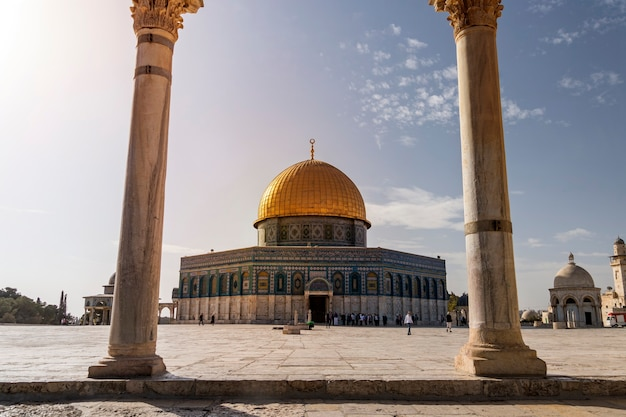 Scenic view of the dome of the rock through the arches of the scales of souls in old city of jerusalem, israel. the islamic shrine shot through the columns of opposite arcade. islamic architecture.