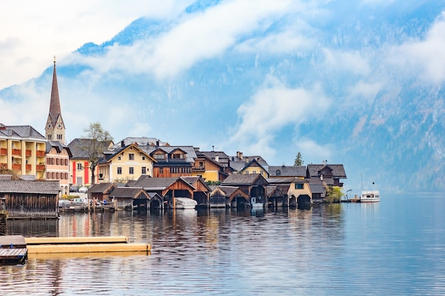 Scenic view of famous hallstatt mountain village with hallstattersee lake and alps mountains summits.