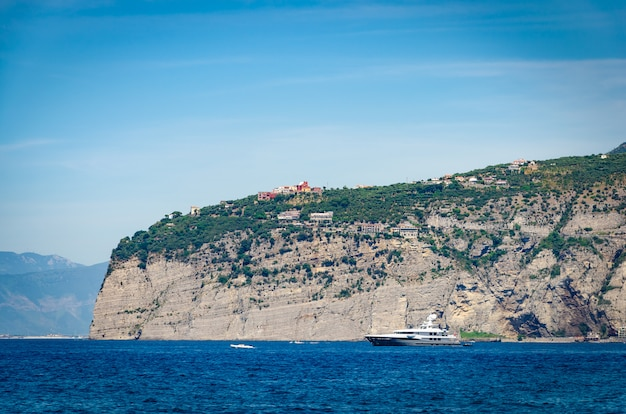 Scenic view of the harbor and cliffs of sorrento on amalfitan coast.