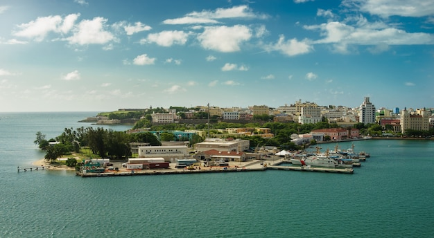 Scenic view of historic colorful puerto rico city in distance with fort in foreground san juan