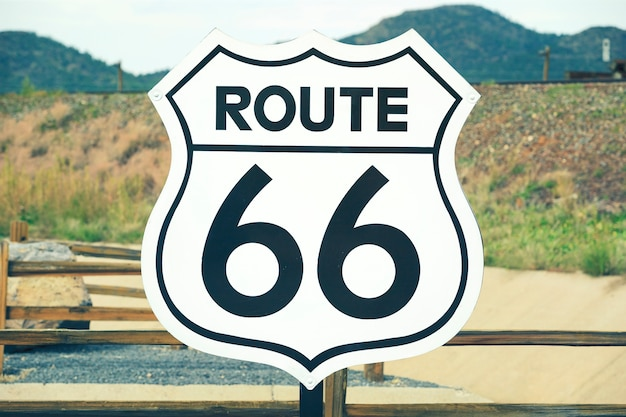 A scenic view of a historic route 66 sign