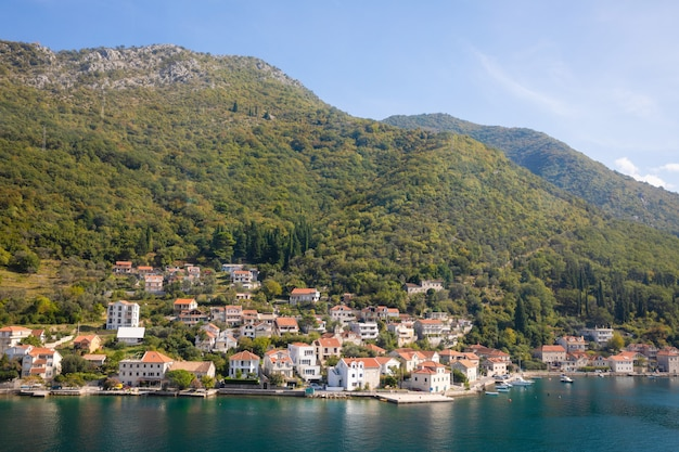 Scenic view of old town, mountains and the coast from water of kotor bay, montenegro