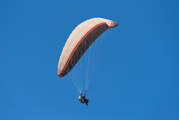 Scenic view of a paraglider on a sunny day.