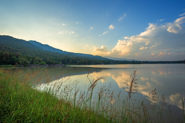 Scenic view of the reservoir huay tueng tao with mountain range forest at evening sunset