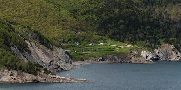 Scenic view of village at coast, meat cove, cape north, cape breton island, nova scotia, canada